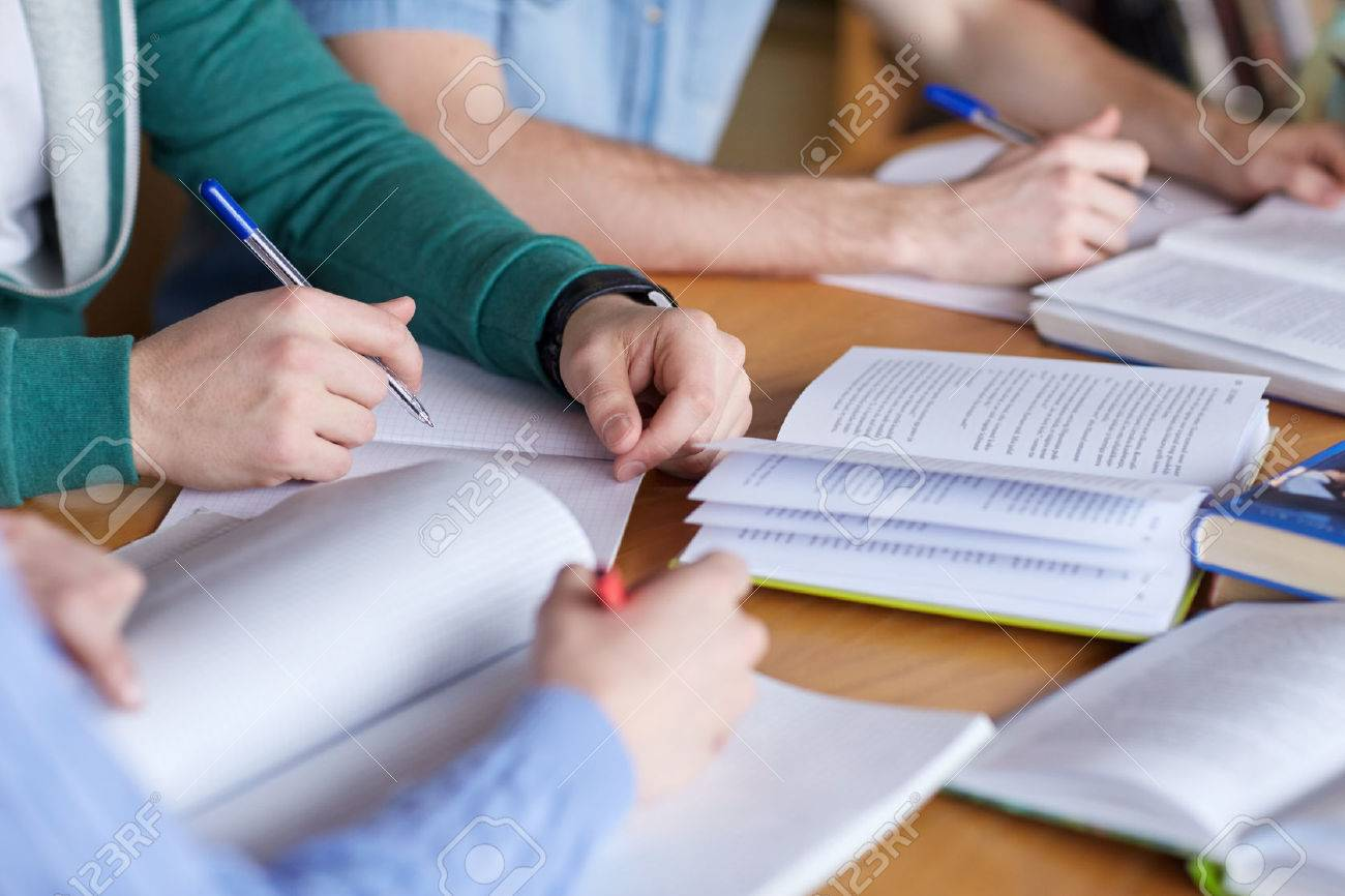 people, learning, education and school concept - close up of students hands with books or textbooks writing to notebooks - 53713431