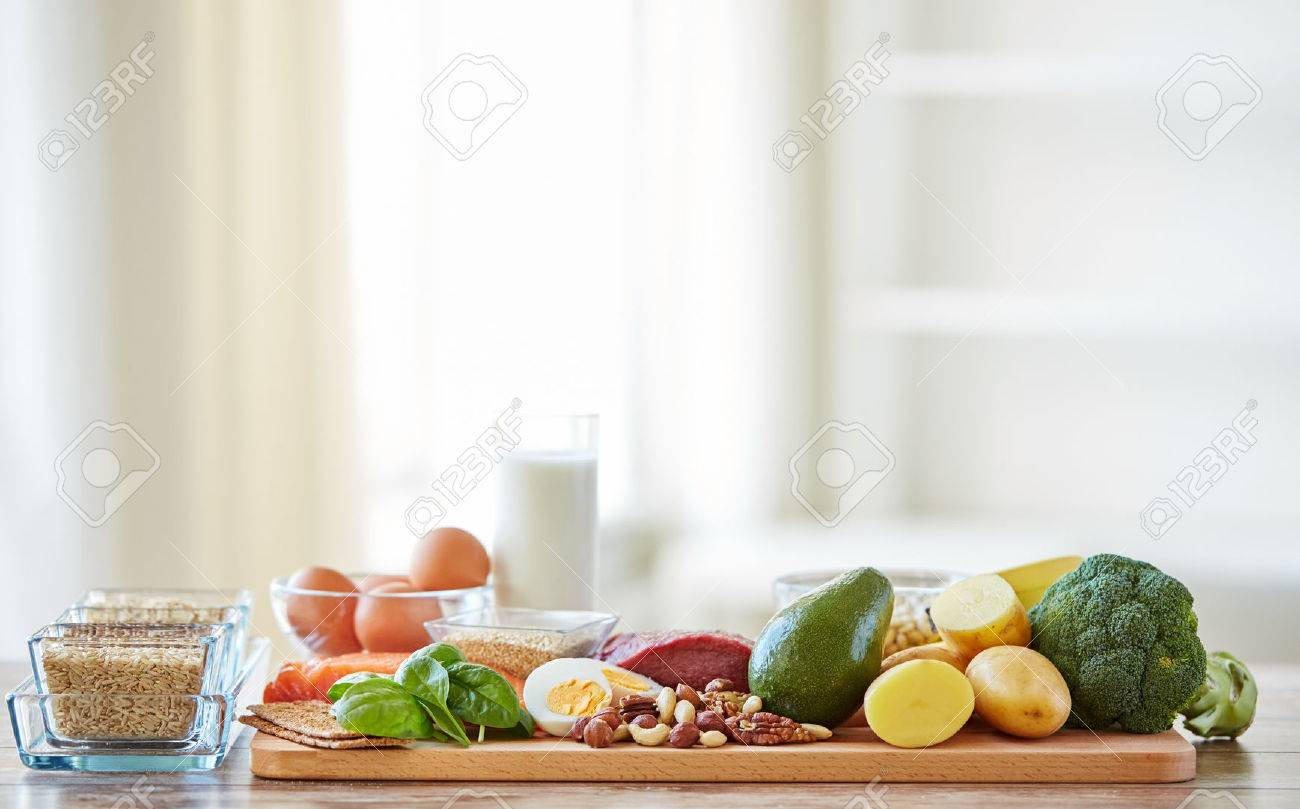 balanced diet, cooking, culinary and food concept - close up of vegetables, fruits and meat on wooden table - 53927720