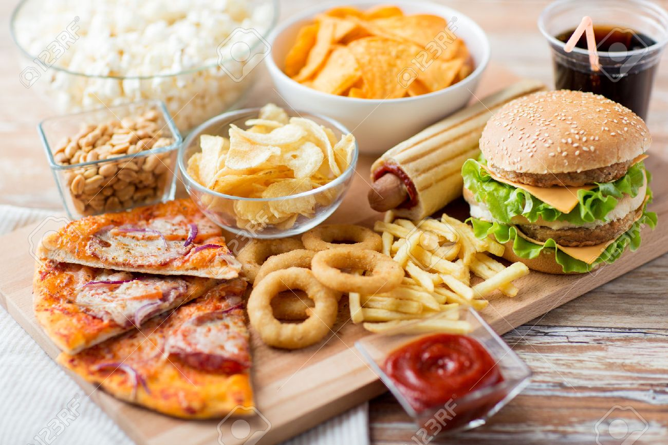 fast food and unhealthy eating concept - close up of fast food snacks and cola drink on wooden table Stock Photo - 55283534