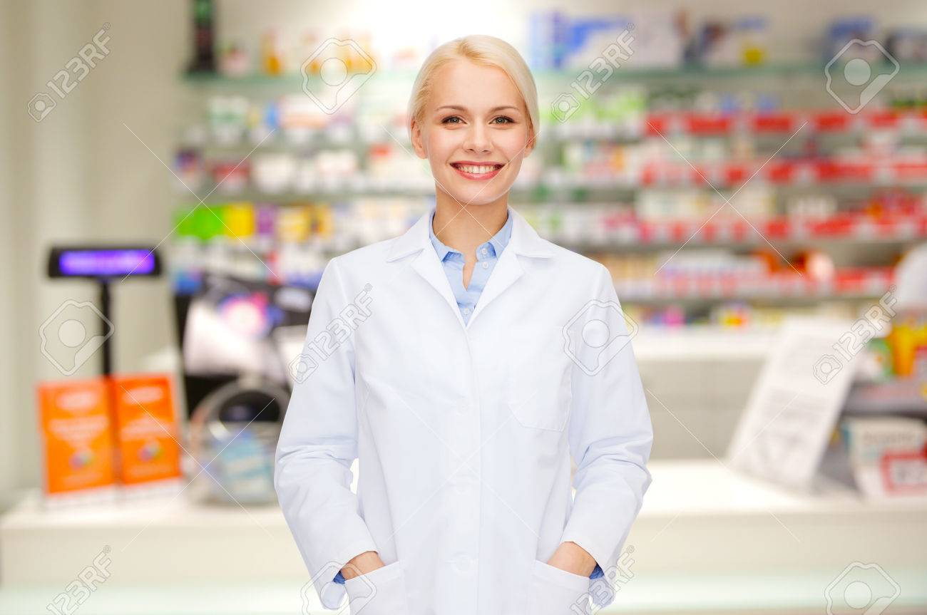 medicine, pharmacy, people, health care and pharmacology concept - happy young woman pharmacist over drugstore background - 54412046