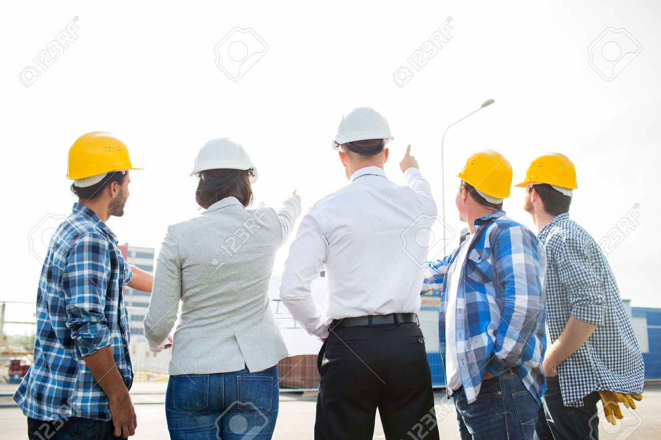 Business building teamwork and people concept group of business building teamwork and people concept group of builders and architects in hardhats malvernweather Images