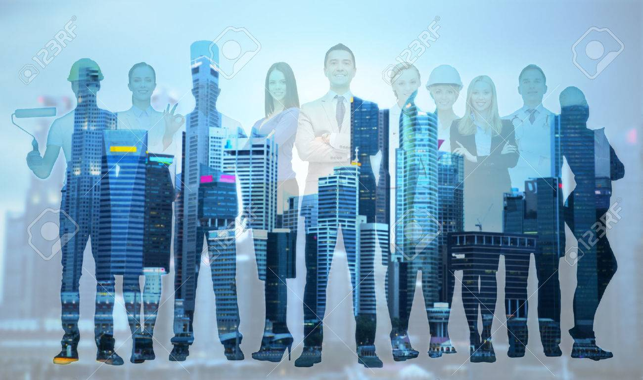 people, profession, qualification, employment and success concept - happy businessman over group of professional workers over city background - 54444686