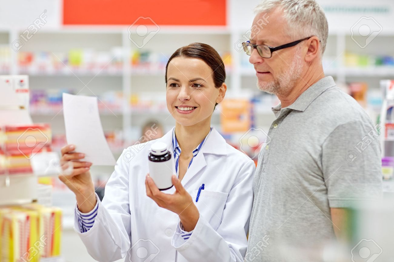 medicine, pharmaceutics, health care and people concept - happy pharmacist and senior man customer with drug and prescription at drugstore - 54776685