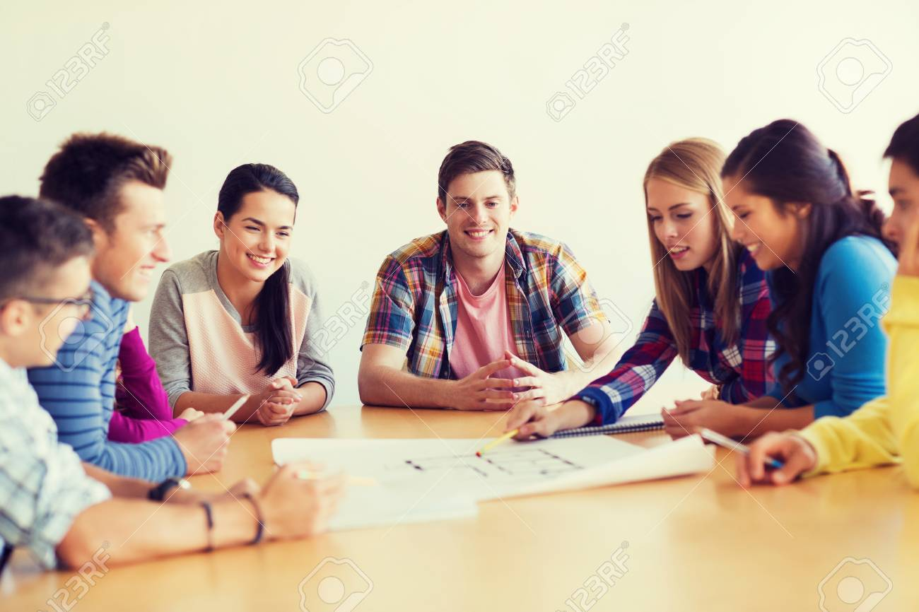 Education school architecture and people concept group of education school architecture and people concept group of smiling students with blueprint meeting malvernweather Image collections