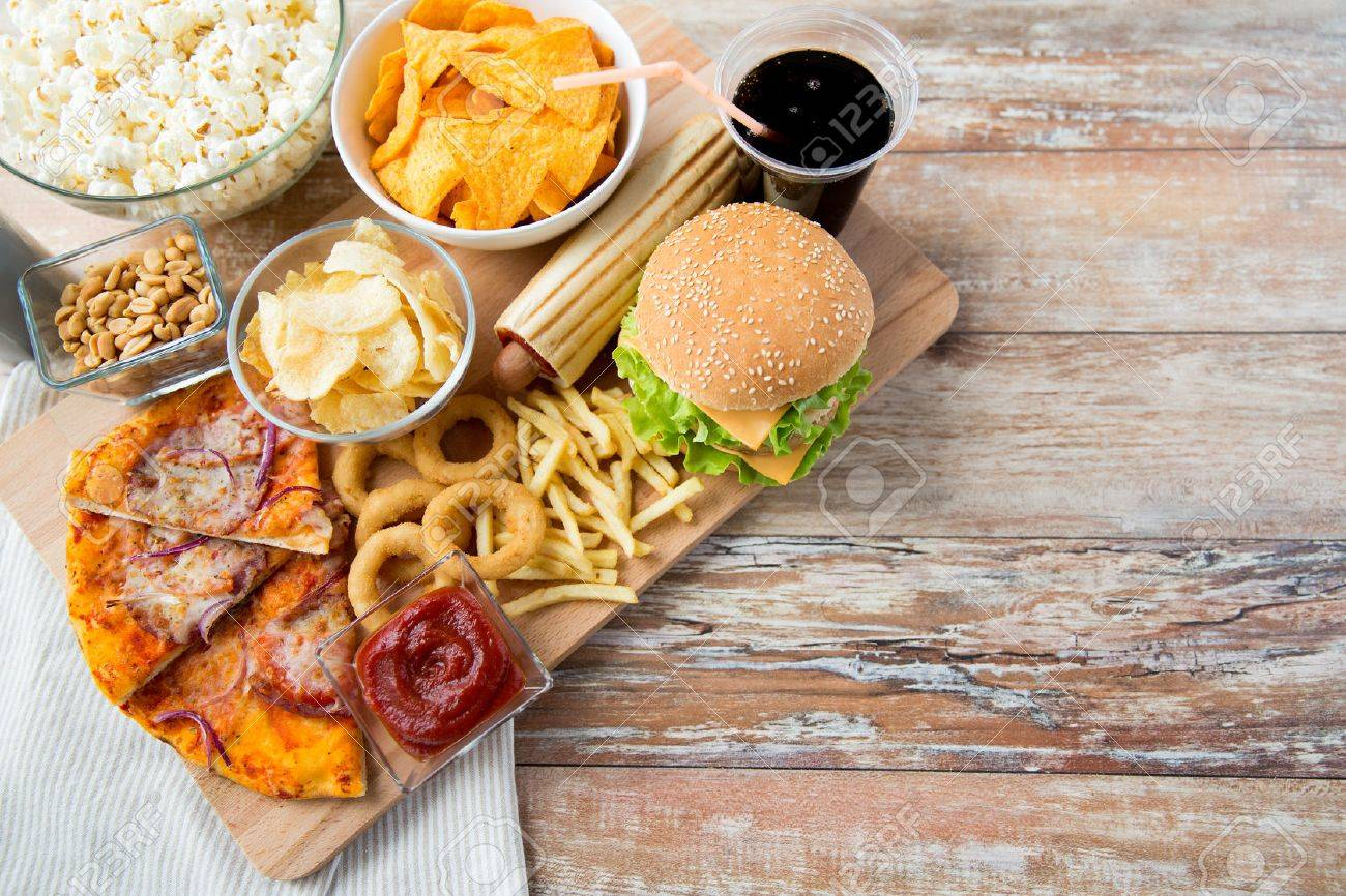 Snack Stock Photos Royalty Free Images Up Fast Food And Unhealthy Eating Concept Close Of Snacks Coca Cola