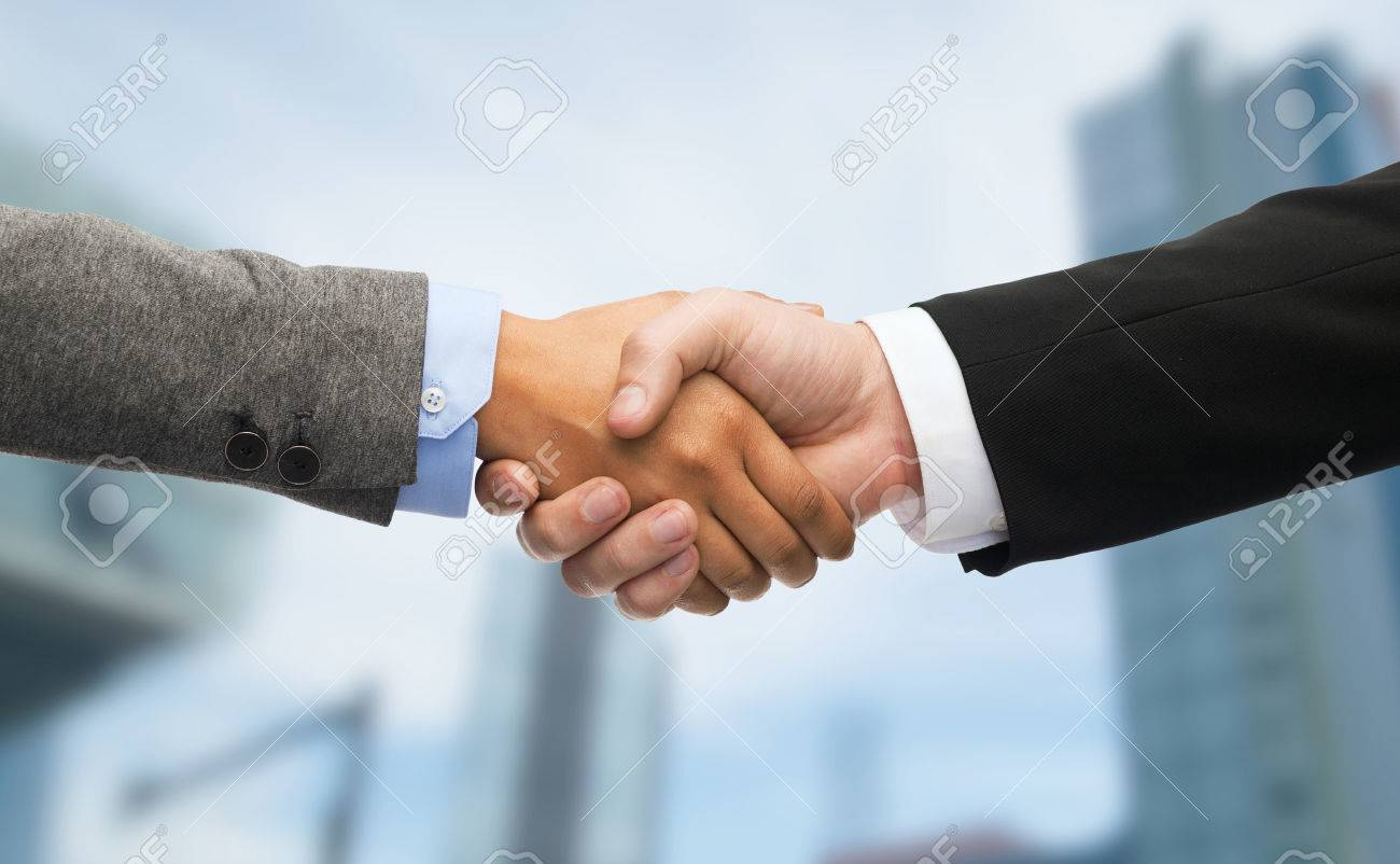business and office concept - businessman and businesswoman shaking hands - 57387243