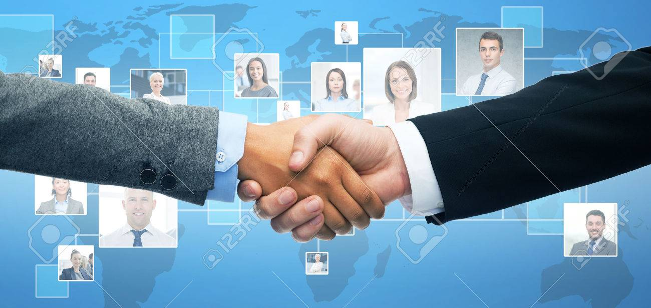 business and office concept - businessman and businesswoman shaking hands - 57472982