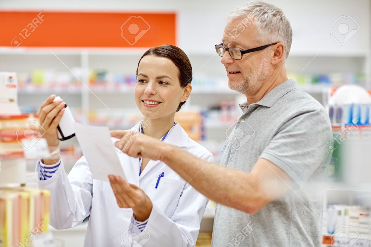 medicine, pharmaceutics, health care and people concept - happy pharmacist and senior man customer with drug and prescription at drugstore - 57532165