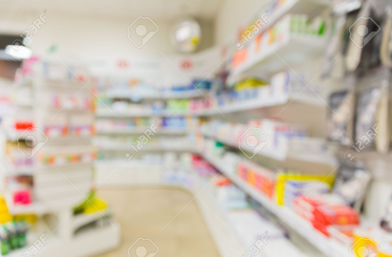 medicine, pharmacy, health care and pharmacology concept - pharmacy or drugstore room blurred background - 58803173