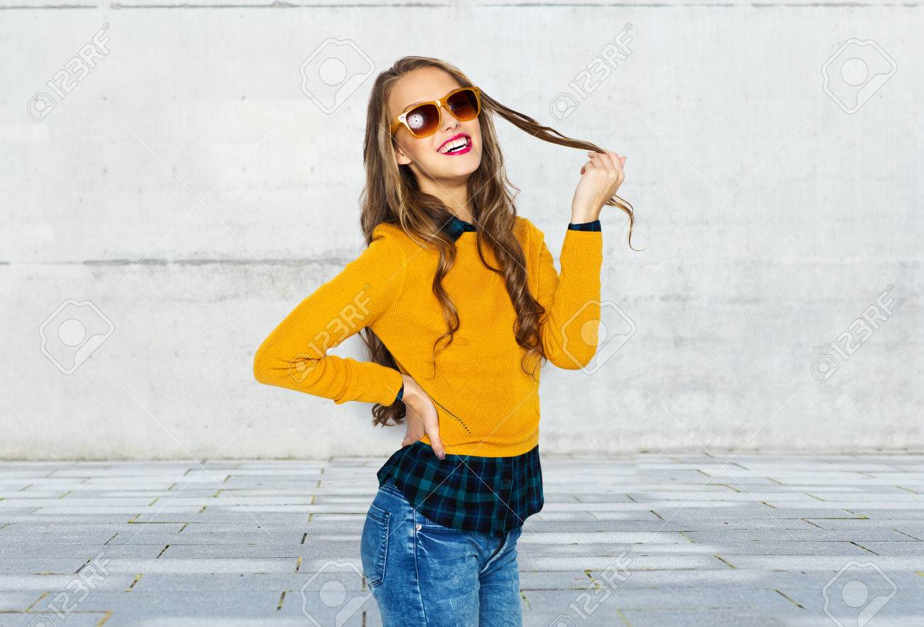 people, style and fashion concept - happy young woman or teen..