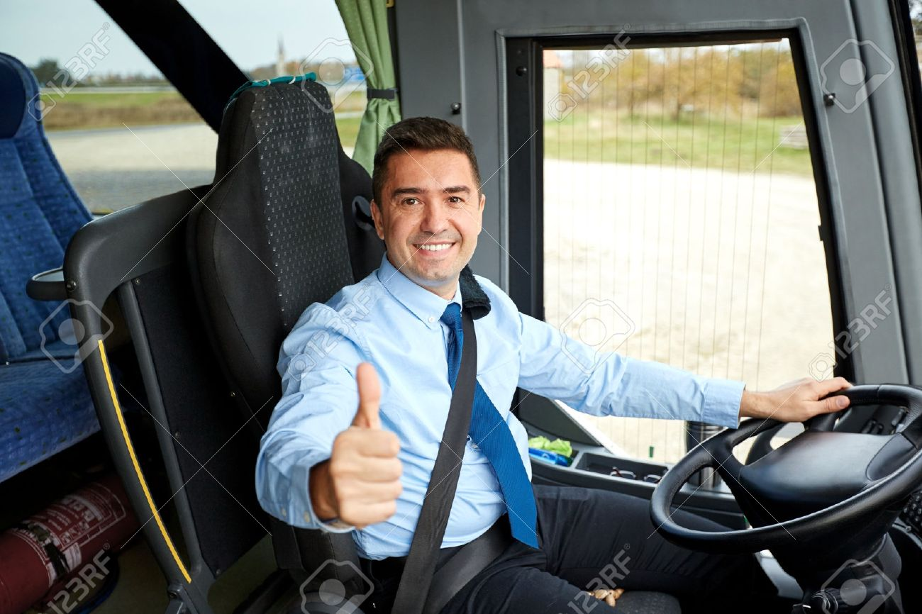 transport, tourism, road trip and people concept - happy driver driving intercity bus and snowing thumbs up - 59097620