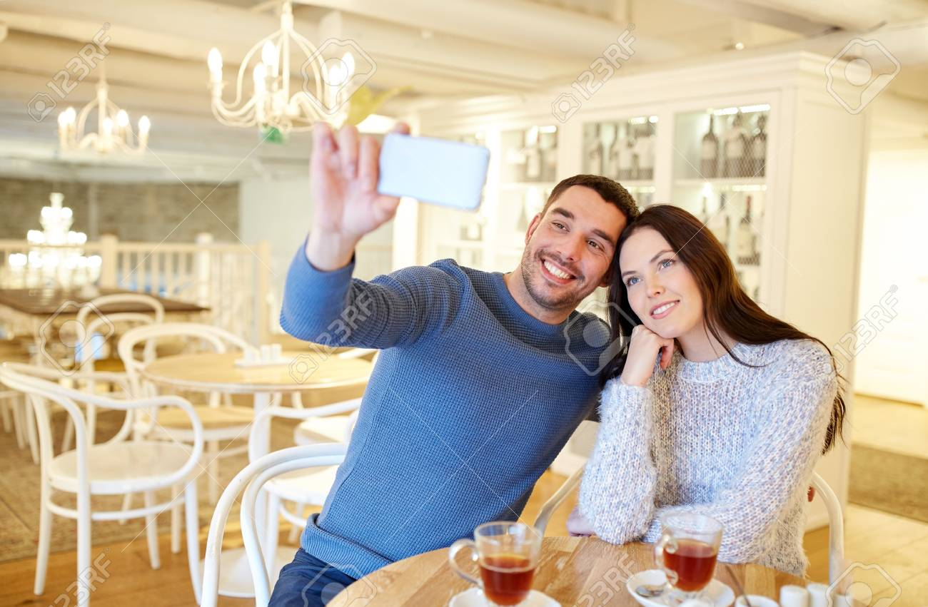 People Technology And Dating Concept Happy Couple Taking Smartphone Stock Photo Picture And Royalty Free Image Image 60087459