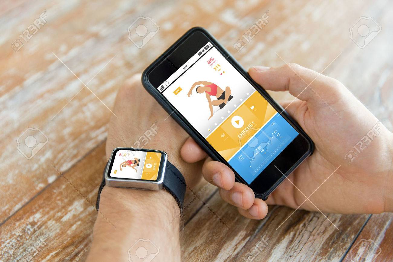 sport, fitness, technology, responsive design and people concept - close up of male hand holding smart phone and wearing watch with sports application on screen - 60347015