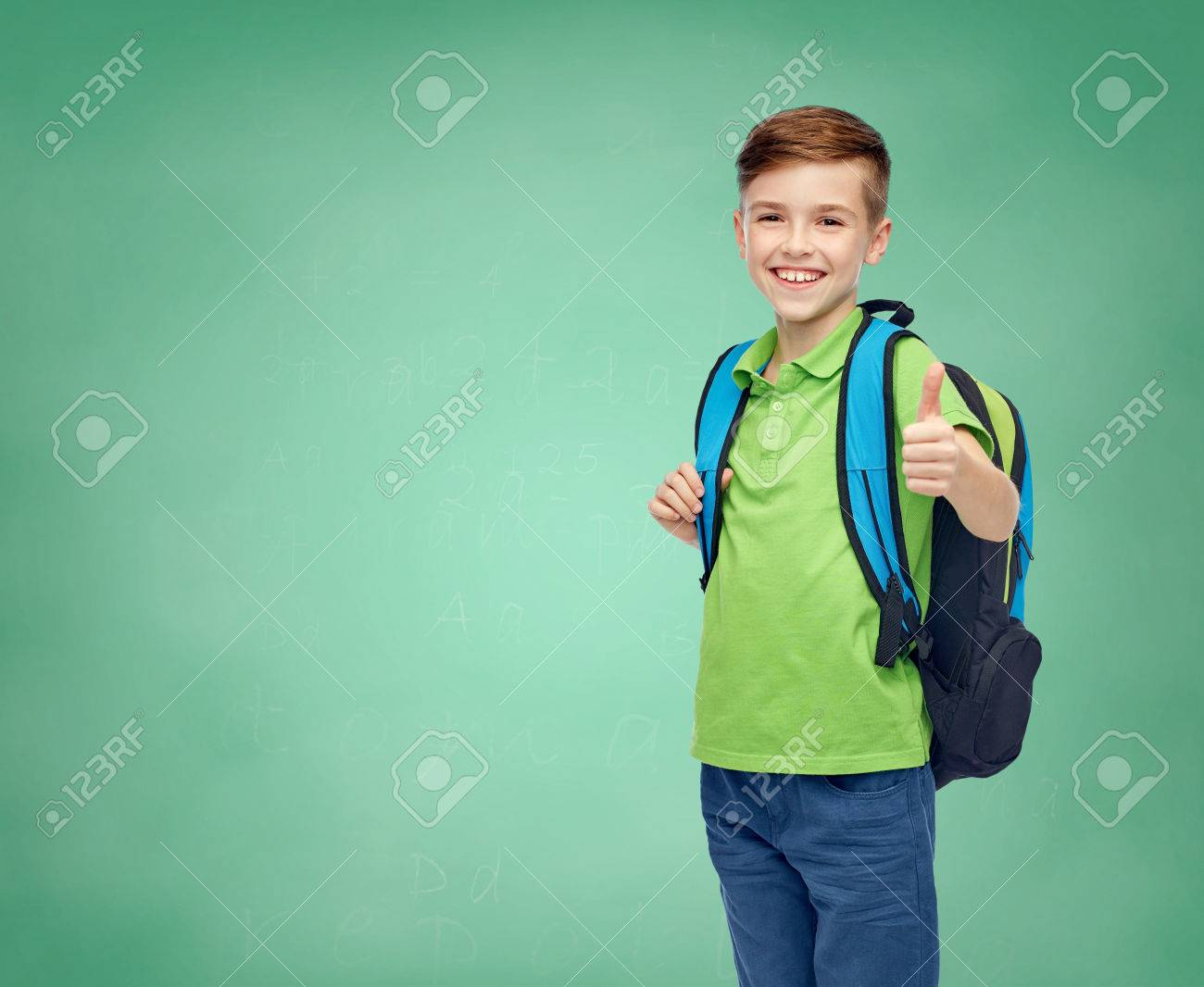 childhood, education and people concept - happy smiling student boy with school bag over green school chalk board background - 61033711