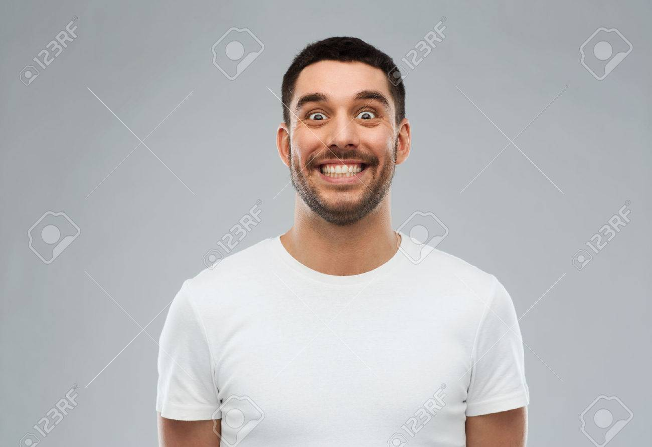 expression and people concept - man with funny face over gray background - 61556271