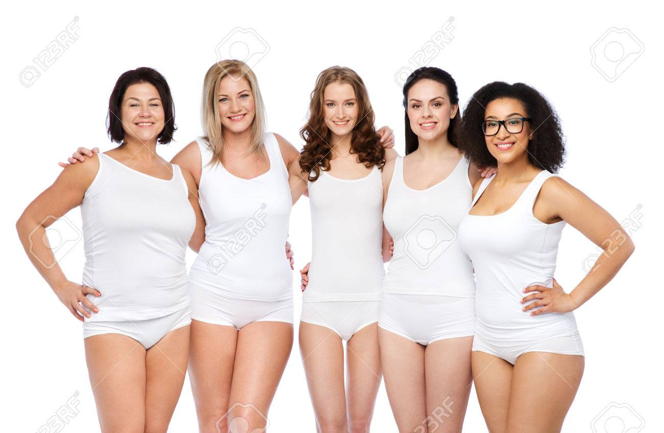 friendship, beauty, body positive and people concept - group of happy women different in white underwear - 61811252