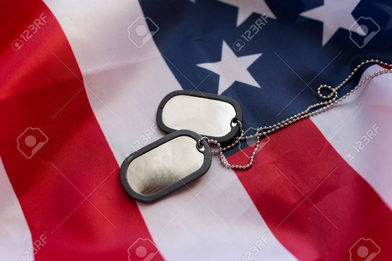 military forces, military service, patriotism and nationalism concept - close up of american flag and soldiers badges - 62832631