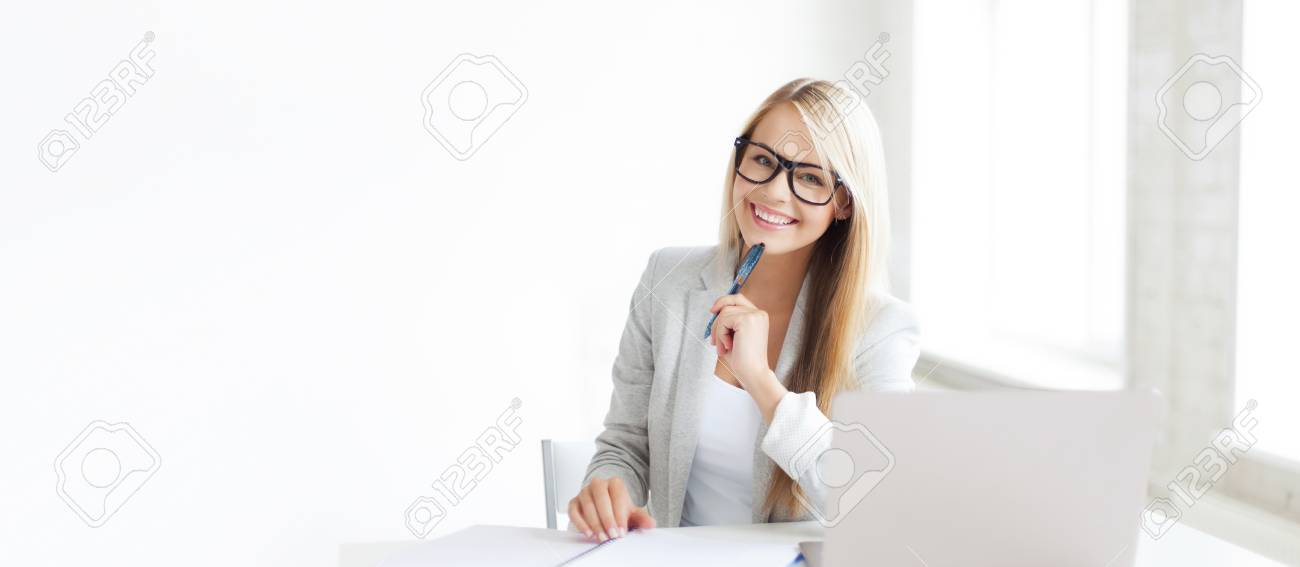 indoor picture of smiling woman with documents and pen - 63415356