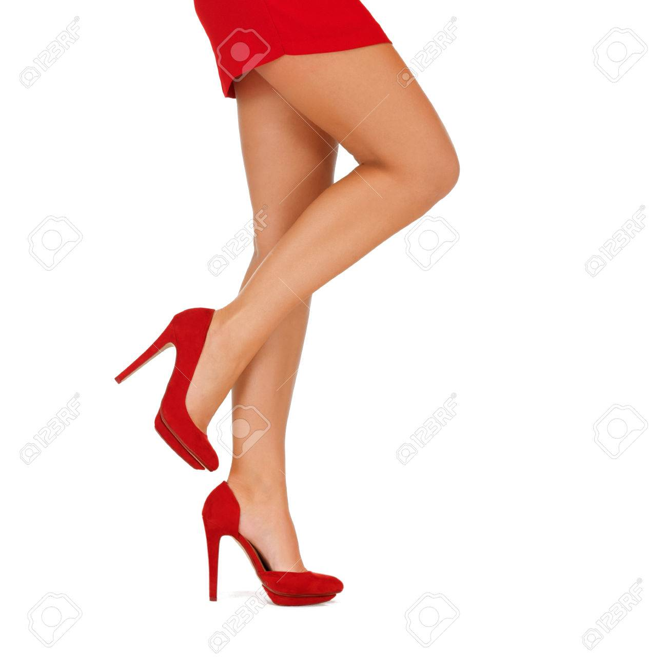 people, fashion and footwear concept - close up of woman legs in red high heeled shoes - 63607290