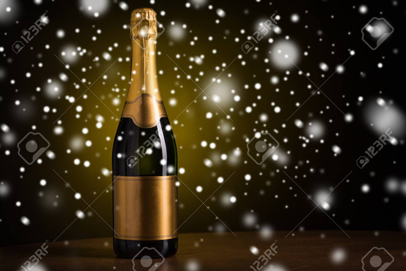 drink alcohol christmas new year and winter holidays concept bottle of champagne