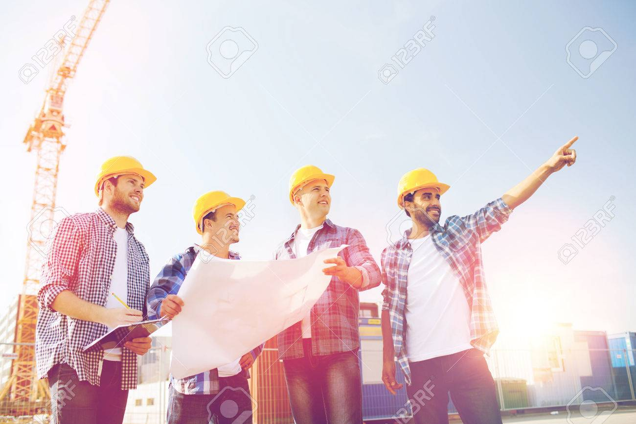 Business building teamwork and people concept group of smiling business building teamwork and people concept group of smiling builders in hardhats with malvernweather Choice Image