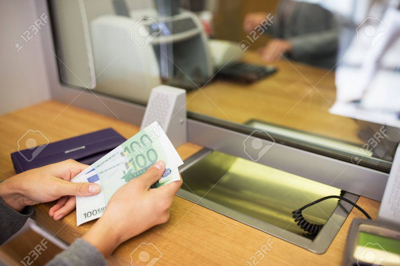people, withdrawal, saving and finance concept - hands with cash money at bank office or currency exchanger Standard-Bild - 67412254