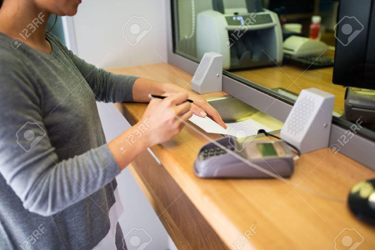 customer writing application at bank office - 68529265
