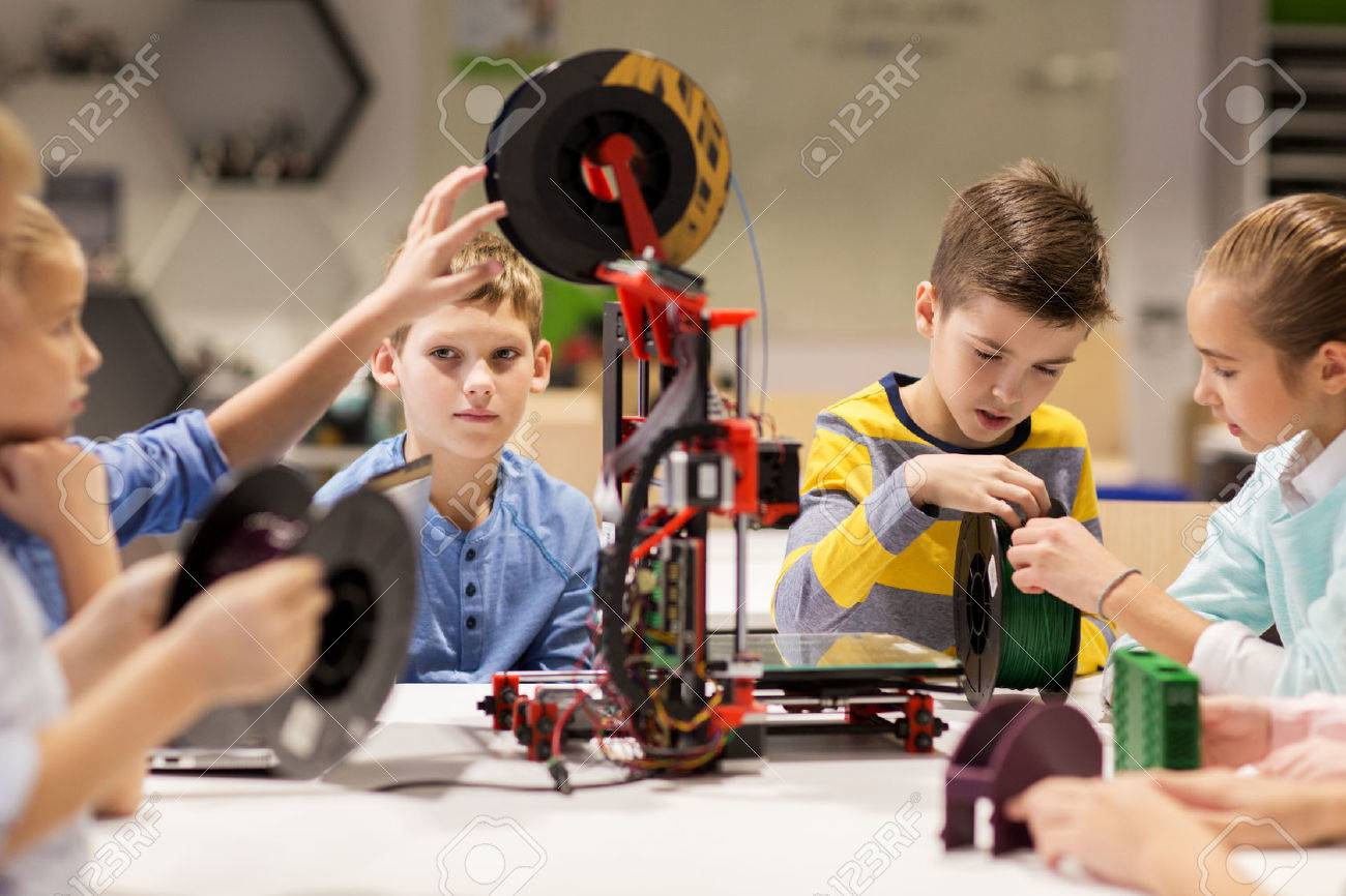 happy children with 3d printer at robotics school Standard-Bild - 68985558