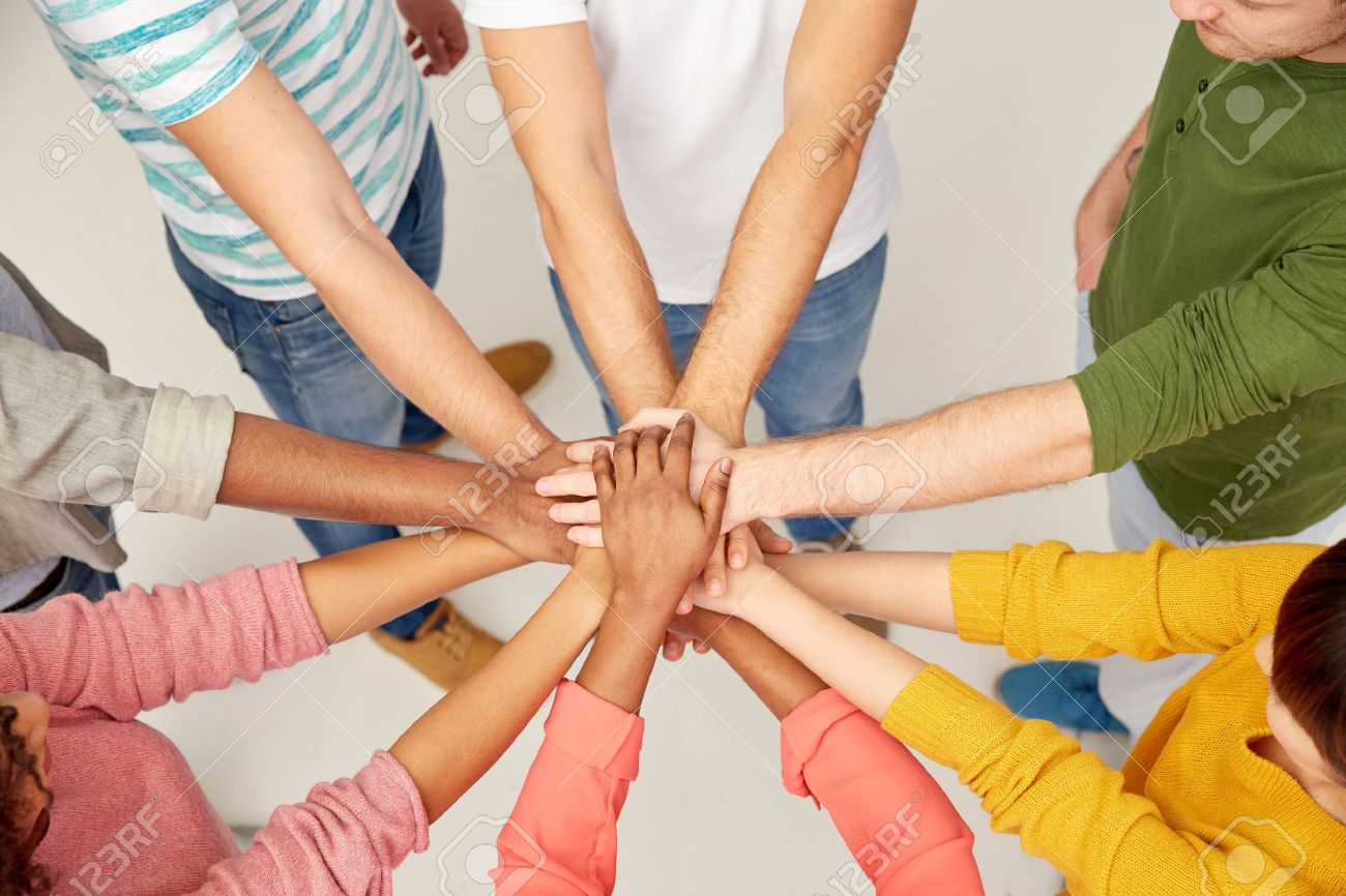 group of international people with hands together Standard-Bild - 70083148