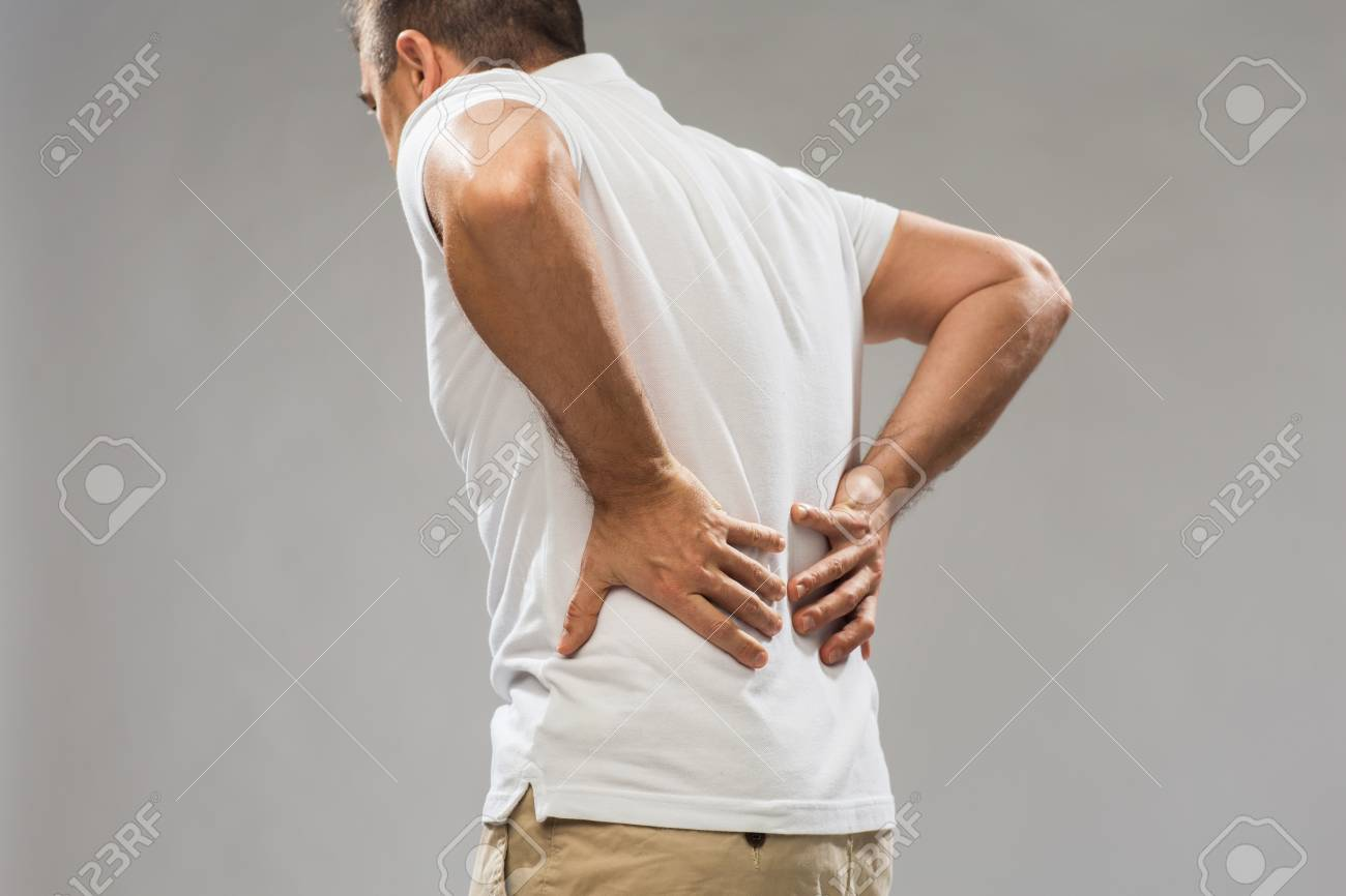 close up of man suffering from backache - 70486341