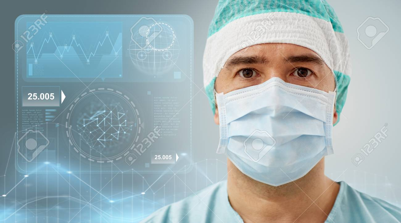 Surgery healthcare medicine and people concept surgeon in stock photo surgery healthcare medicine and people concept surgeon in mask with diagram and virtual screen projection ccuart Images