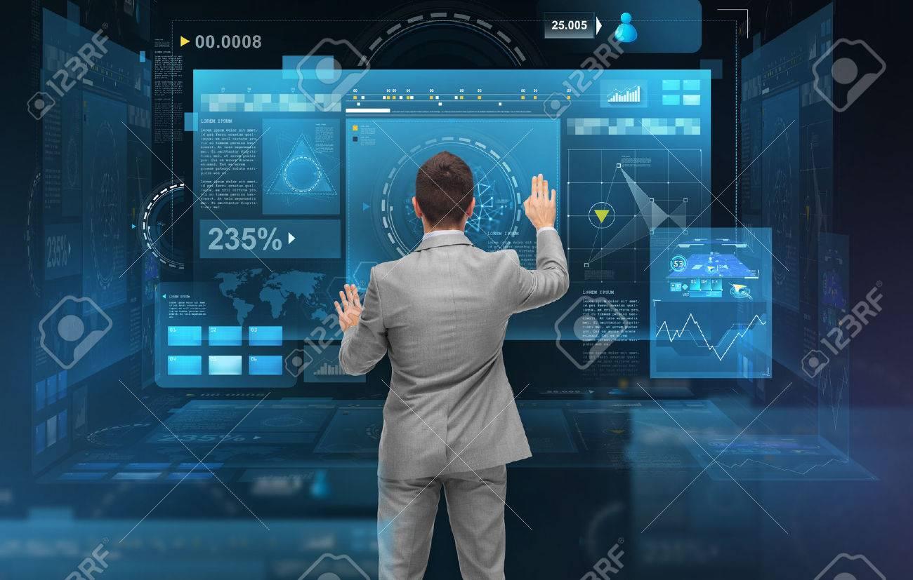businessman working with virtual screens Standard-Bild - 72799775