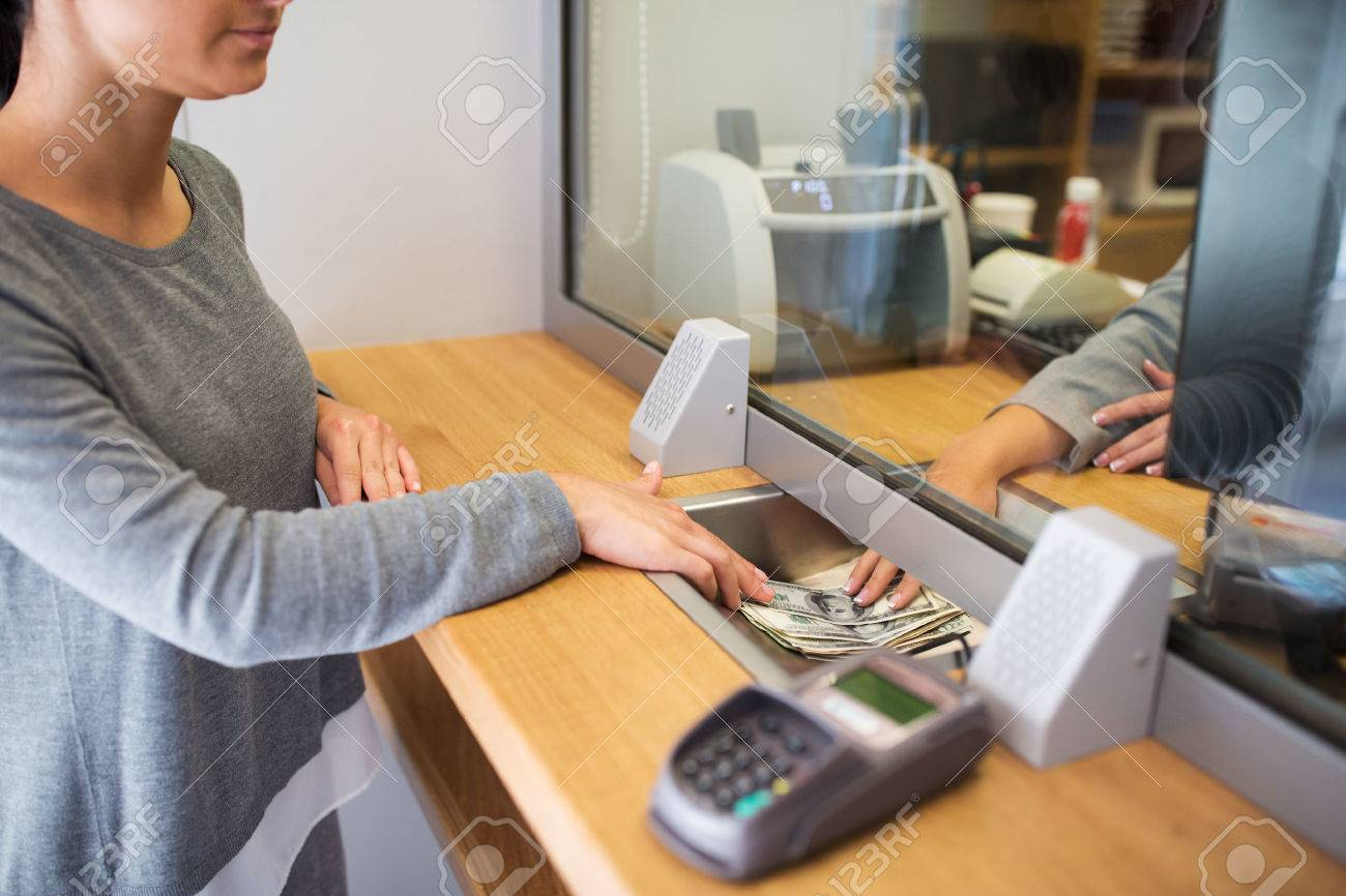 clerk giving cash money to customer at bank office Standard-Bild - 72886290