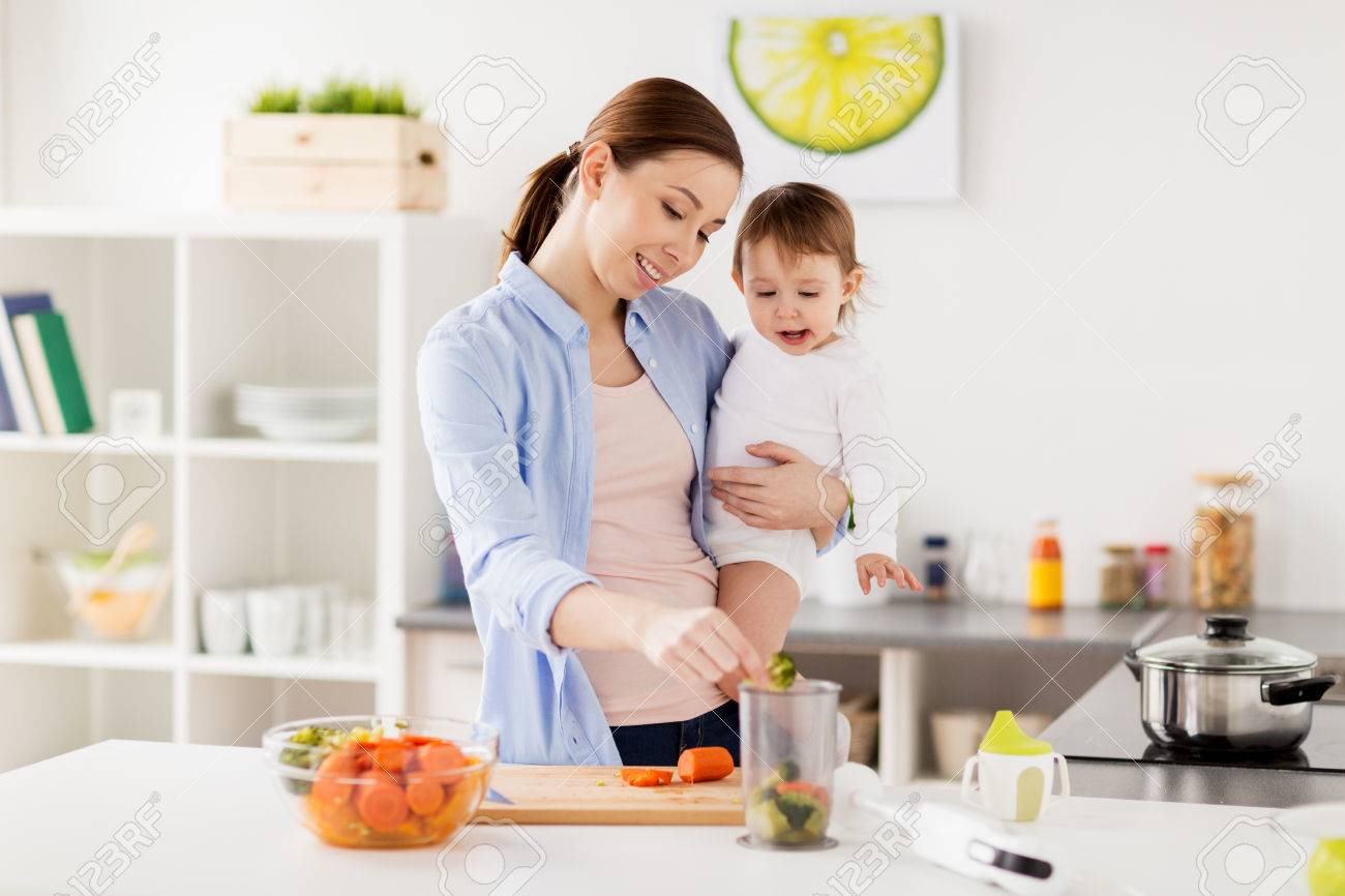 Happy mother and baby cooking food at home kitchen stock photo 78748950