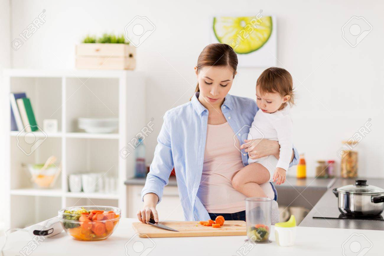 Happy mother and baby cooking food at home kitchen stock photo 80282796