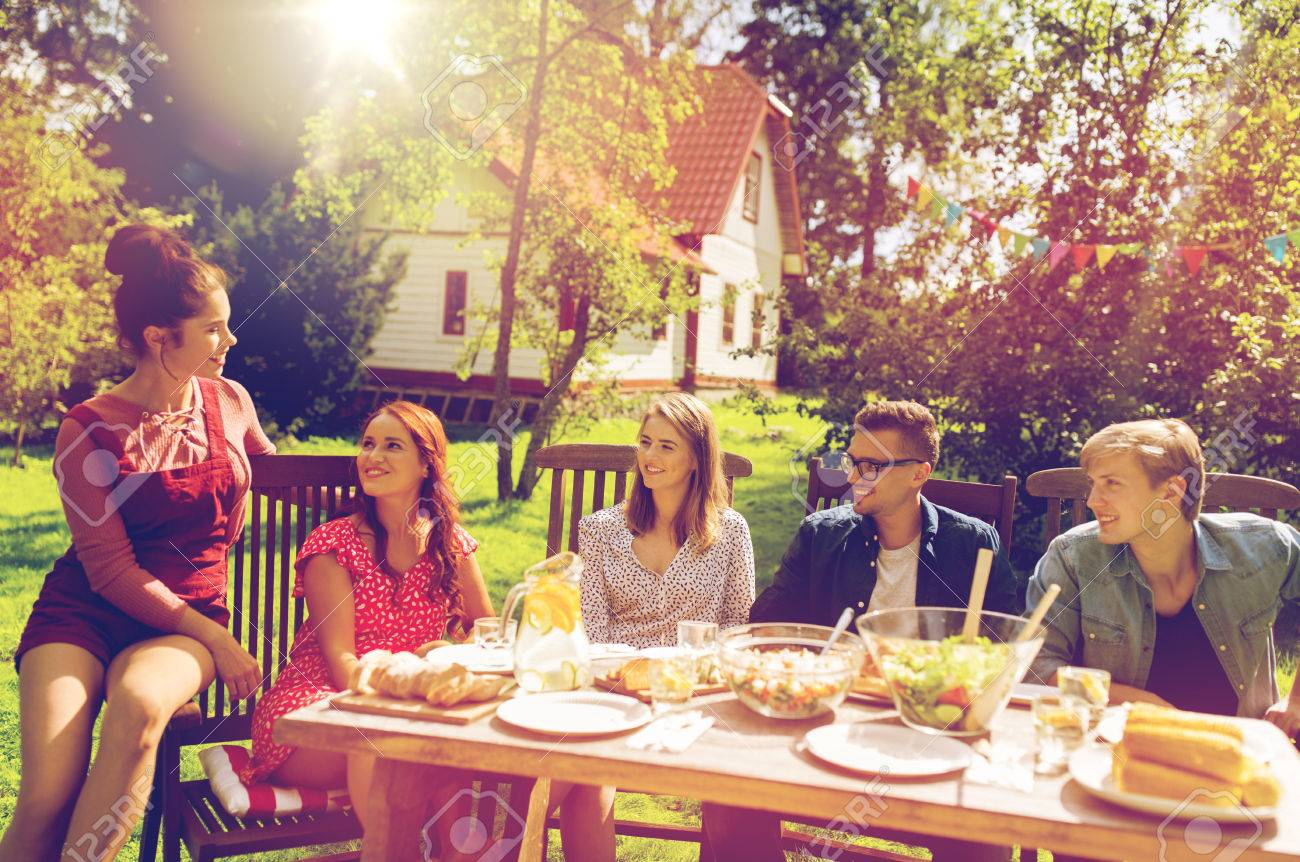 Happy Friends Having Dinner At Summer Garden Party Stock Photo Picture And Royalty Free Image Image 84554583