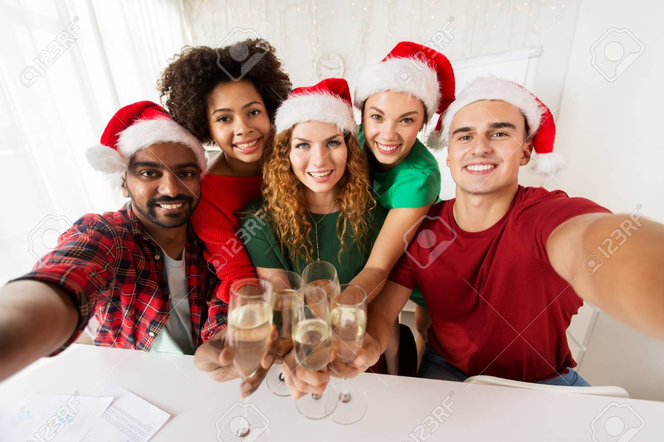 Happy Team Celebrating Christmas At Office Party Stock Photo ...