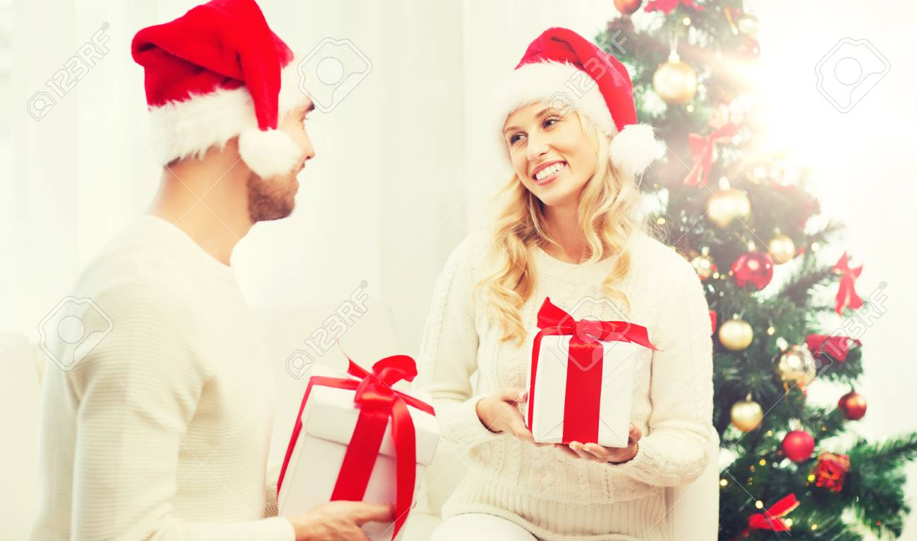 Happy Couple At Home Exchanging Christmas Gifts Stock Photo, Picture ...