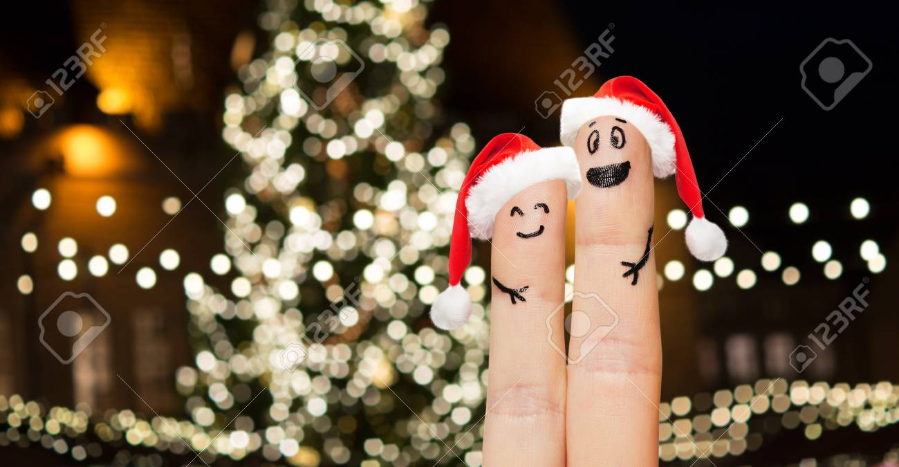 Two Fingers In Santa Hats Over Christmas Tree Stock Photo, Picture ...
