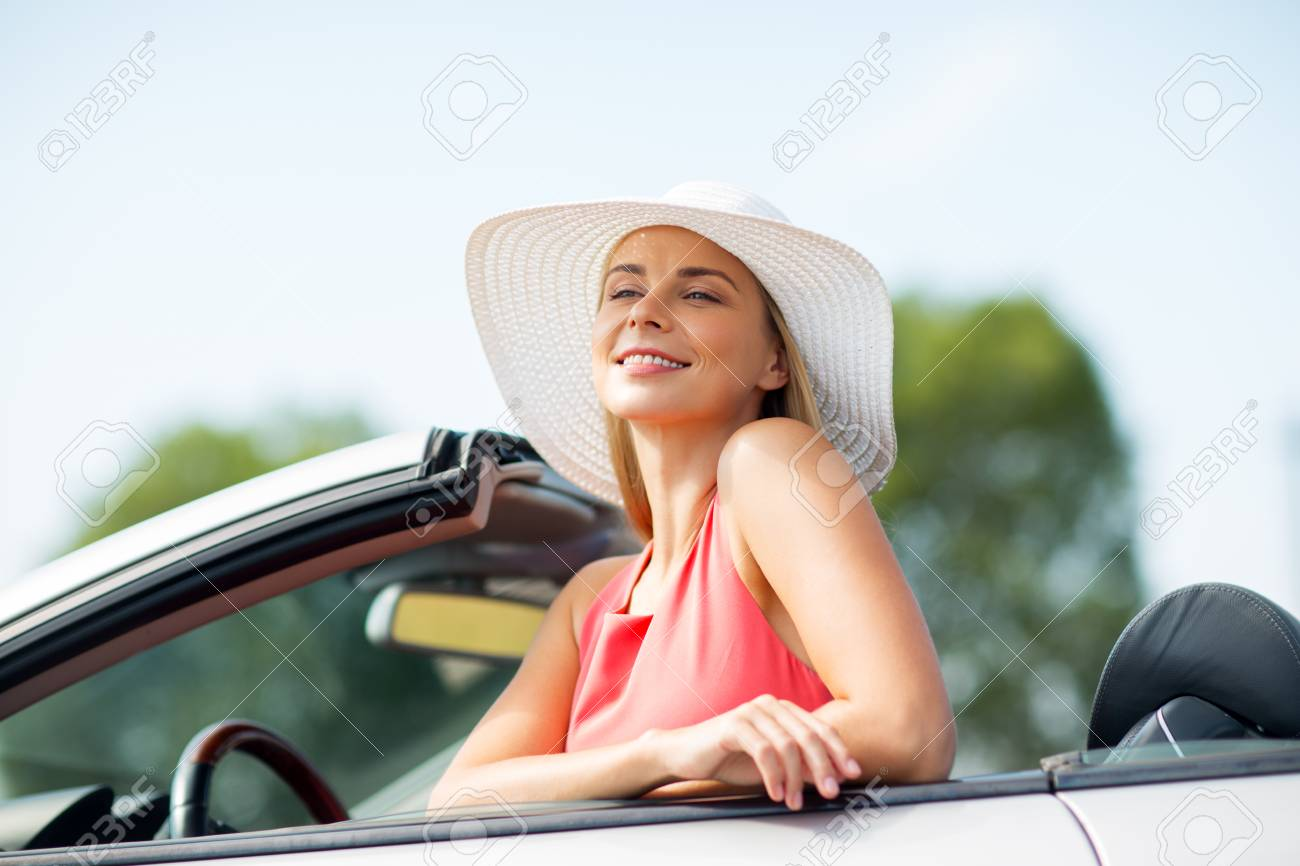 596335fd9 happy young woman in convertible car