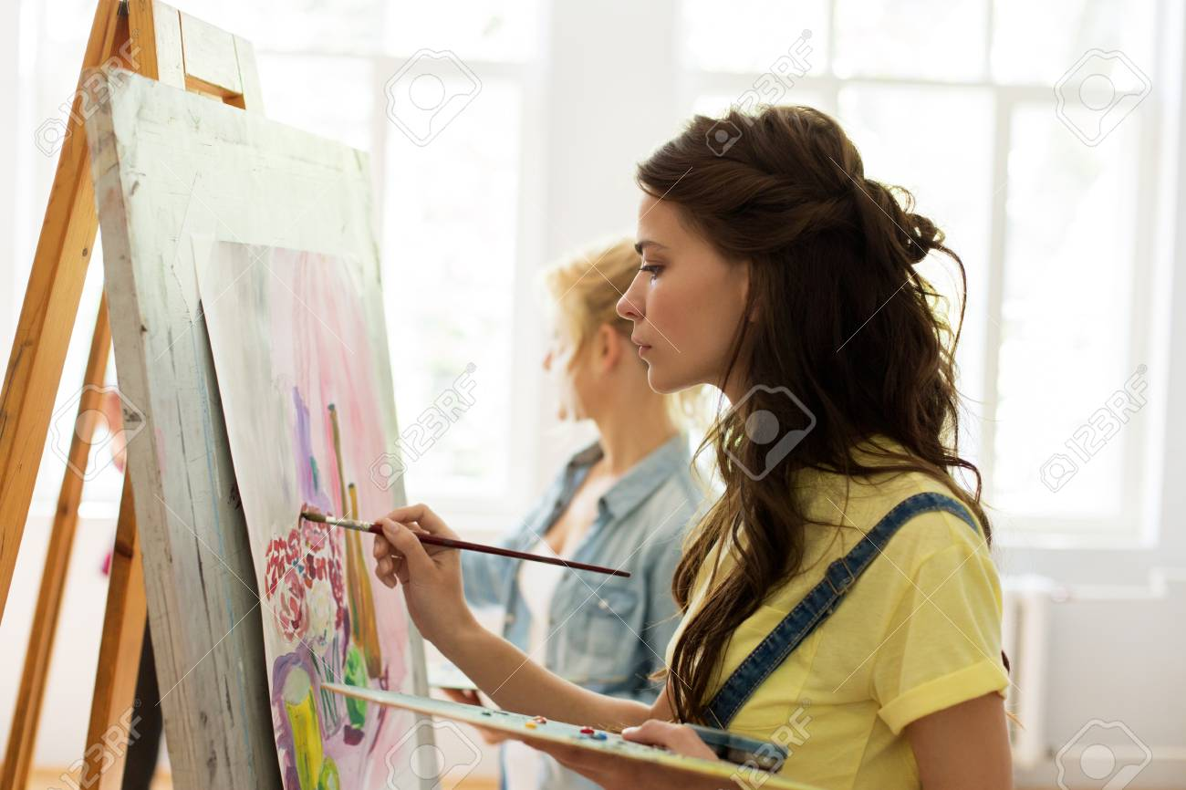 art school, creativity and people concept - woman with easel,