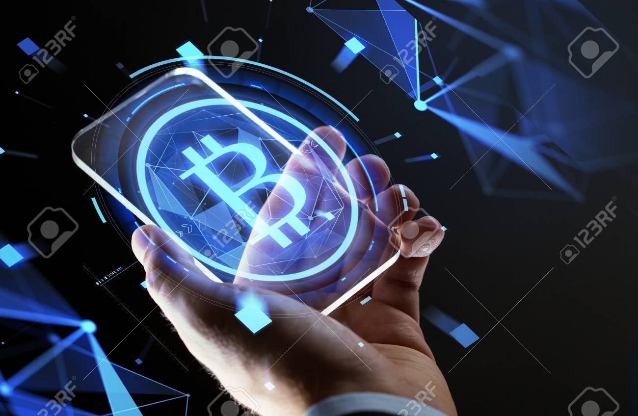 close up of hand with smartphone and bitcoin Standard-Bild - 93215311