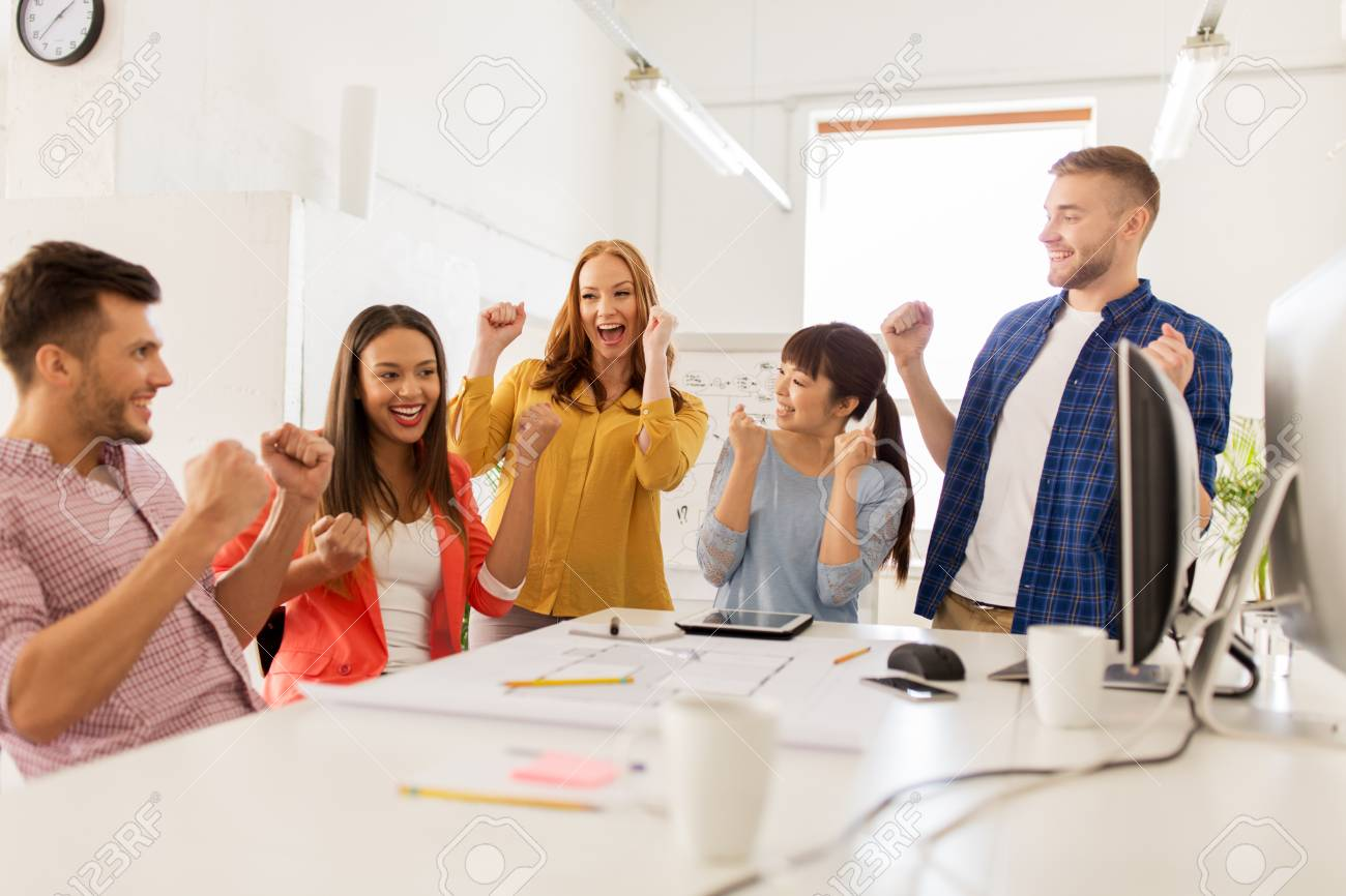 Happy Creative Team Celebrating Success At Office Stock Photo Picture And Royalty Free Image Image 95138944