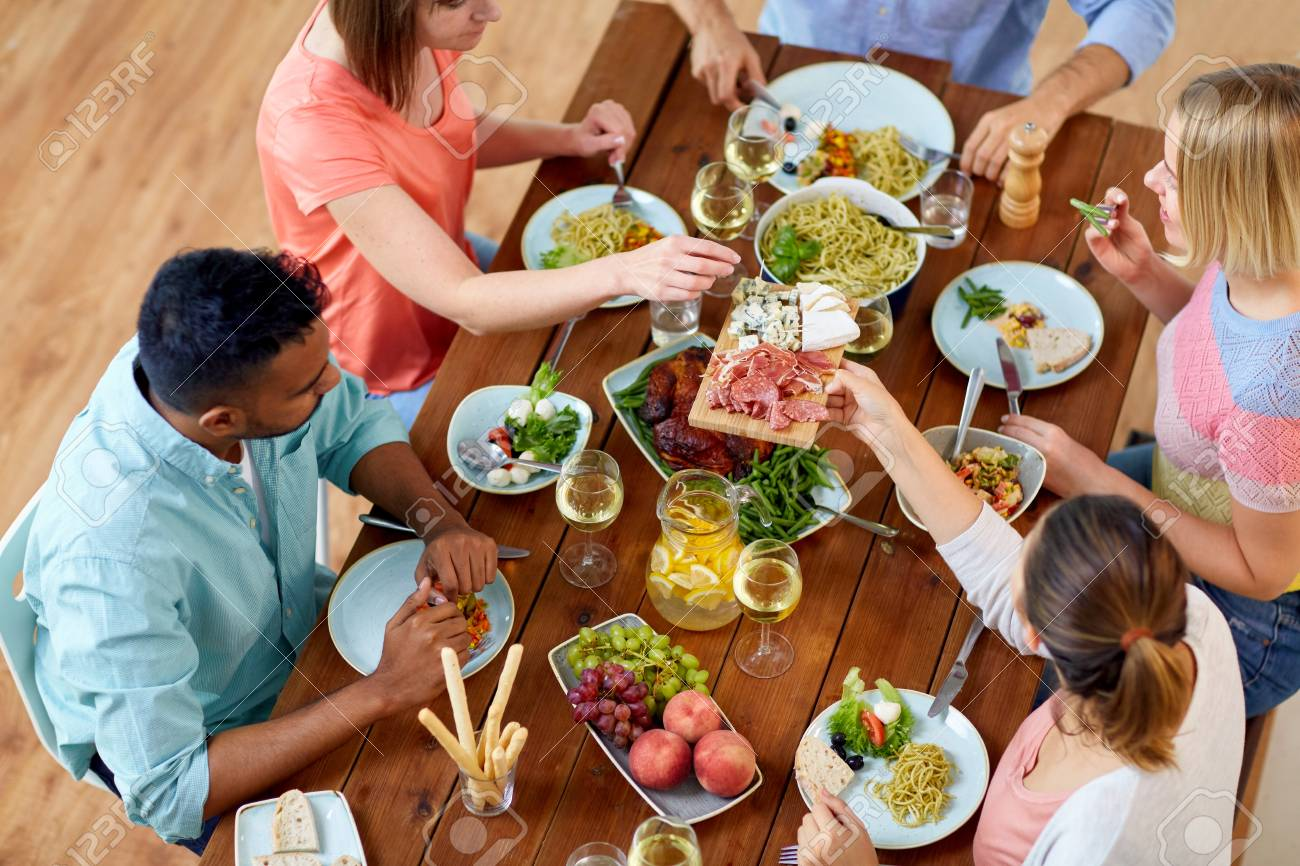 Miraculous Group Of People Eating At Table With Food Download Free Architecture Designs Embacsunscenecom