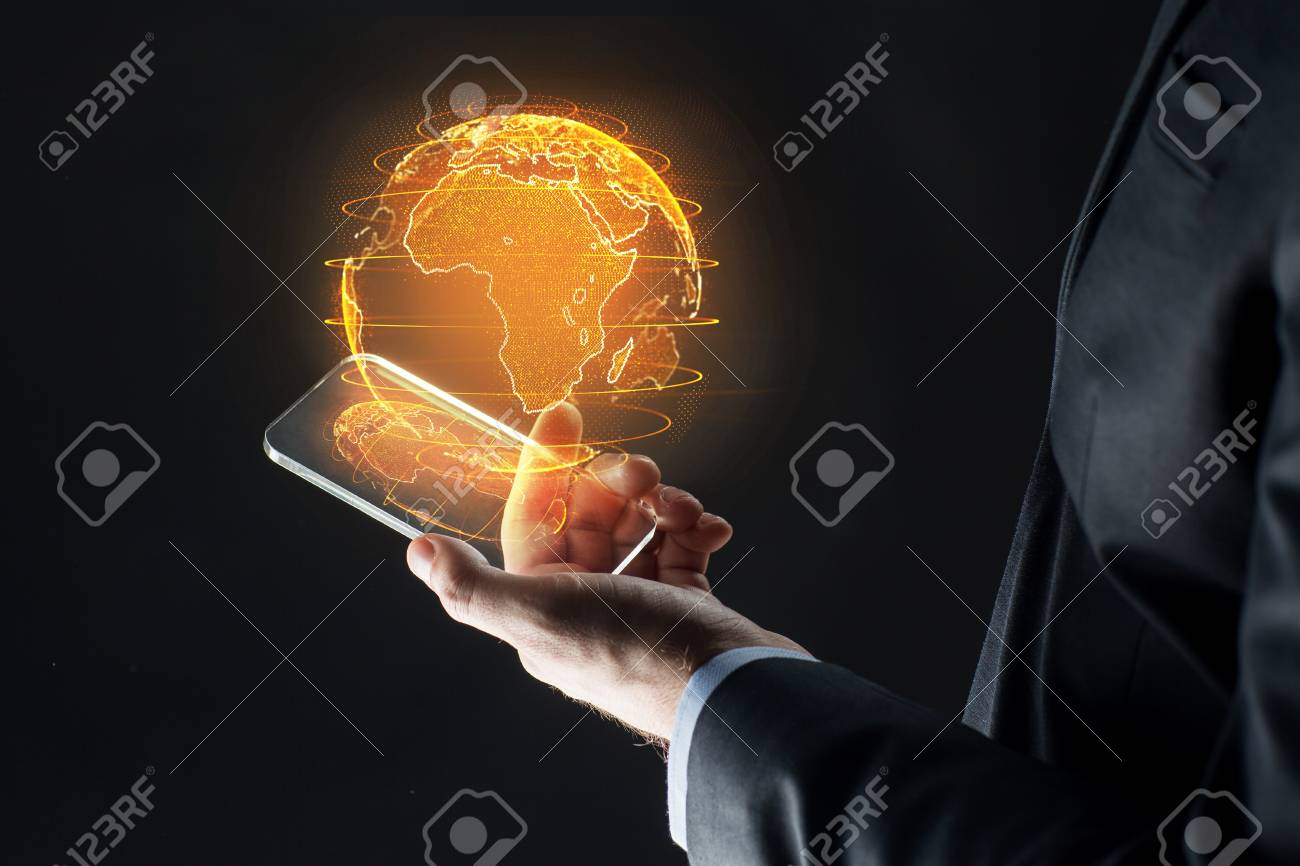 hand with smartphone and earth hologram - 101468820