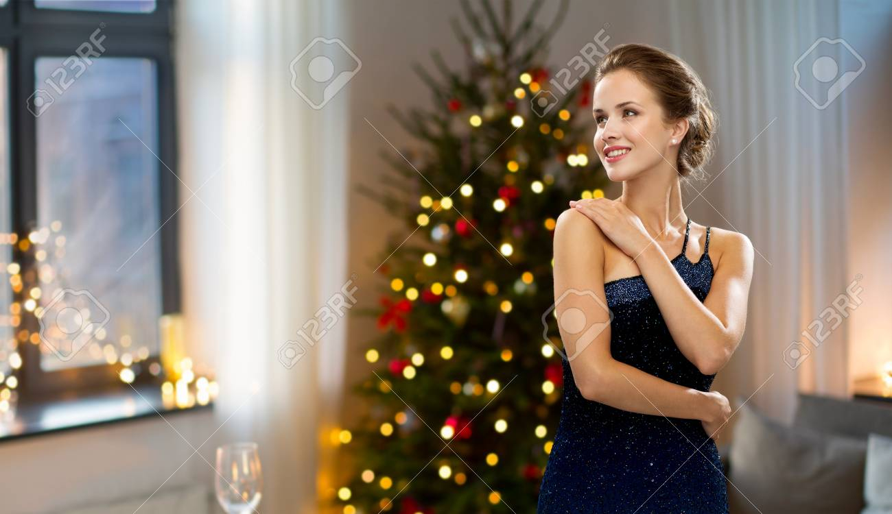 At Home Christmas Trees.Beautiful Woman At Home Over Christmas Tree Lights