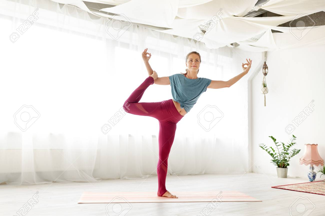 Young Woman Doing Yoga One Legged Pose At Studio Lizenzfreie Fotos