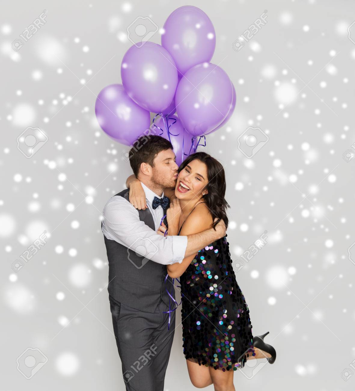 happy couple with violet balloons kissing at party - 110623124