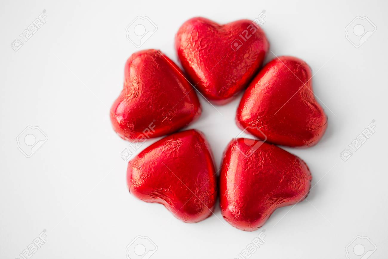 close up of red heart shaped chocolate candies - 112908466
