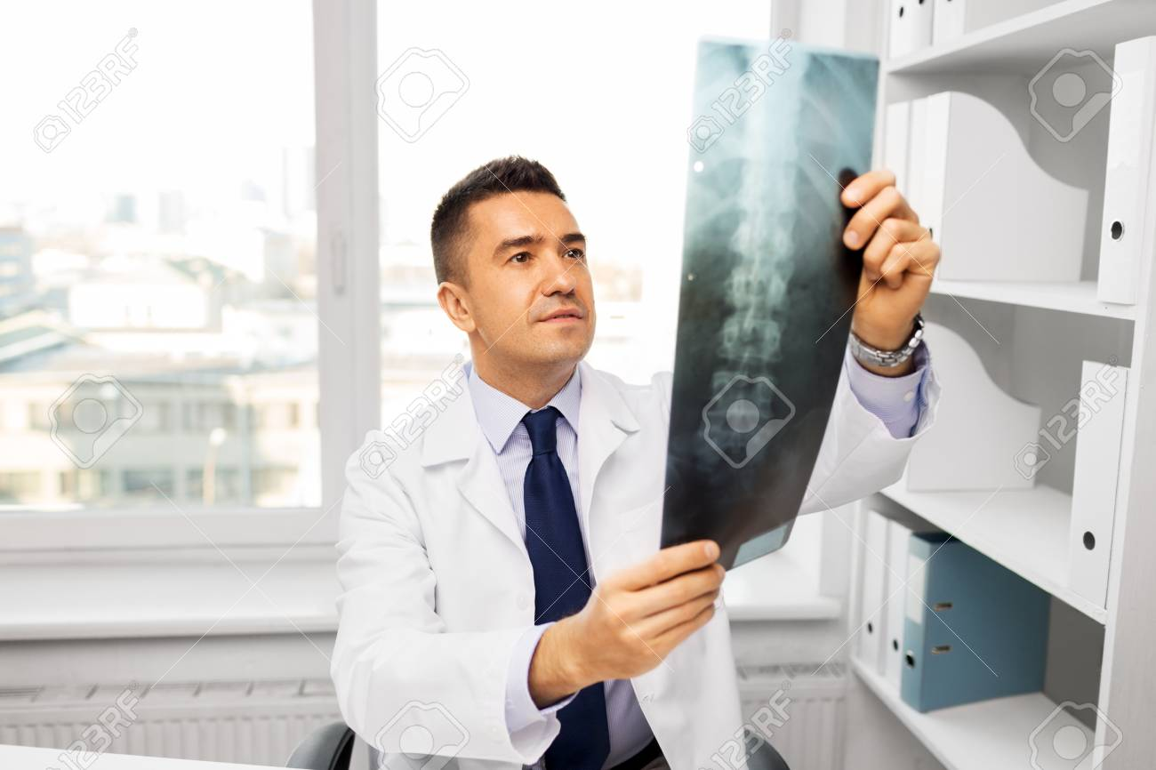 doctor with x-ray scan at hospital - 115184831